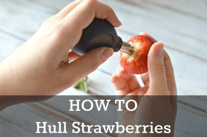 "how to hull a strawberry demonstration with text on image ""how to hull strawberries"" for pinterest"