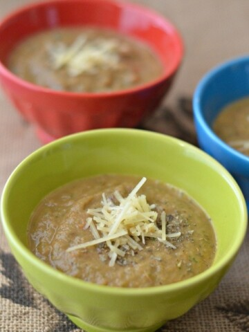 Sauteed Zucchini Puree in bowls topped with seasoning and parmesan cheese