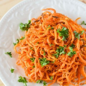 Baked Spiralized Sweet Potato Fries with Garlic and Parsley | oxo hand-held spiralizer