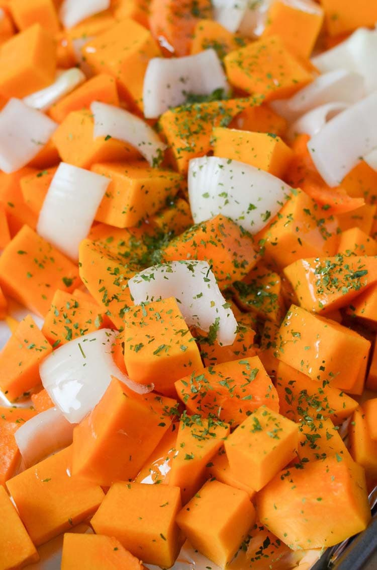 seasoned butternut squash ready to be roasted on a sheet pan