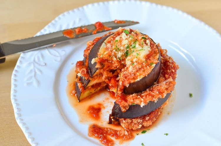 Easy Eggplant Parmesan Recipe using a thick and hearty sauce, cheeses and herbs. This is a simple dinner recipe that you can make in less than 30 minutes!