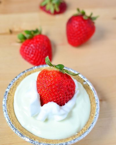 Mini Key Lime Pie with Fresh Strawberries - a quick refreshing and dessert recipe. Have a sweet tooth? Enjoy this as an easy snack! Packed with protein and fruit!