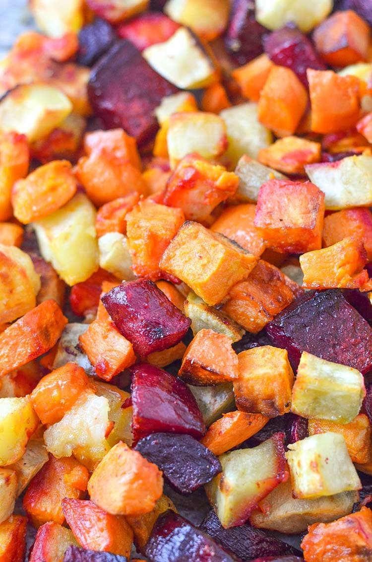 oven roasted beets and sweet potatoes on a sheet pan