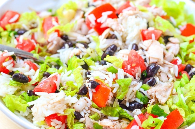 close up of chicken burrito bowl in a low bowl