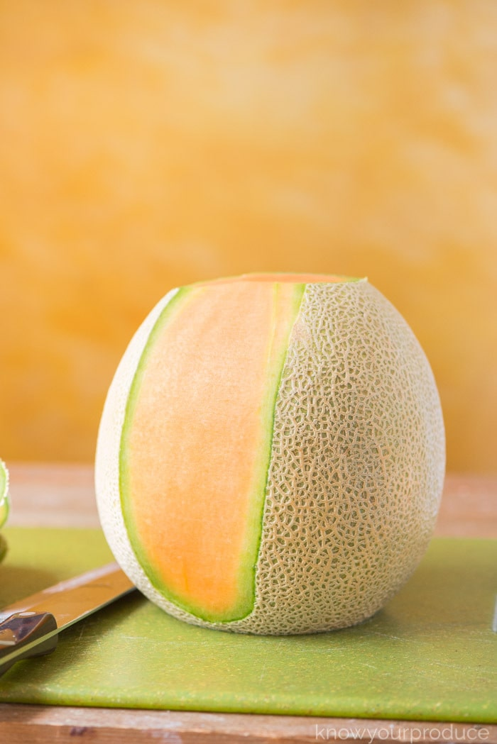 how to cut a cantaloupe - cut off rind