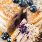 blueberry pancakes on fork cut with fresh blueberryes