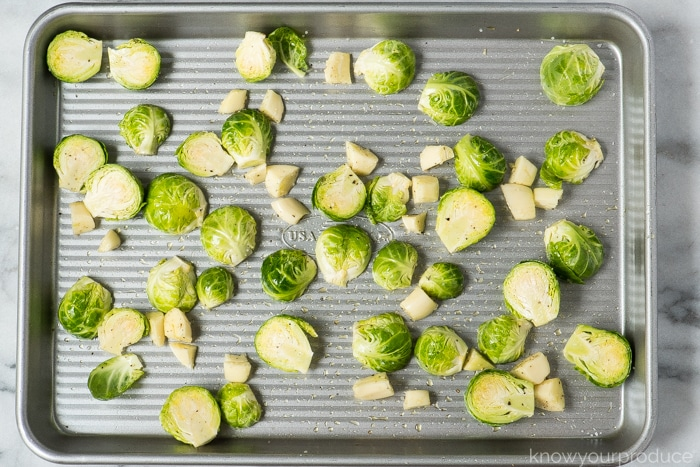 brussels sprouts and garlic on a sheet pan