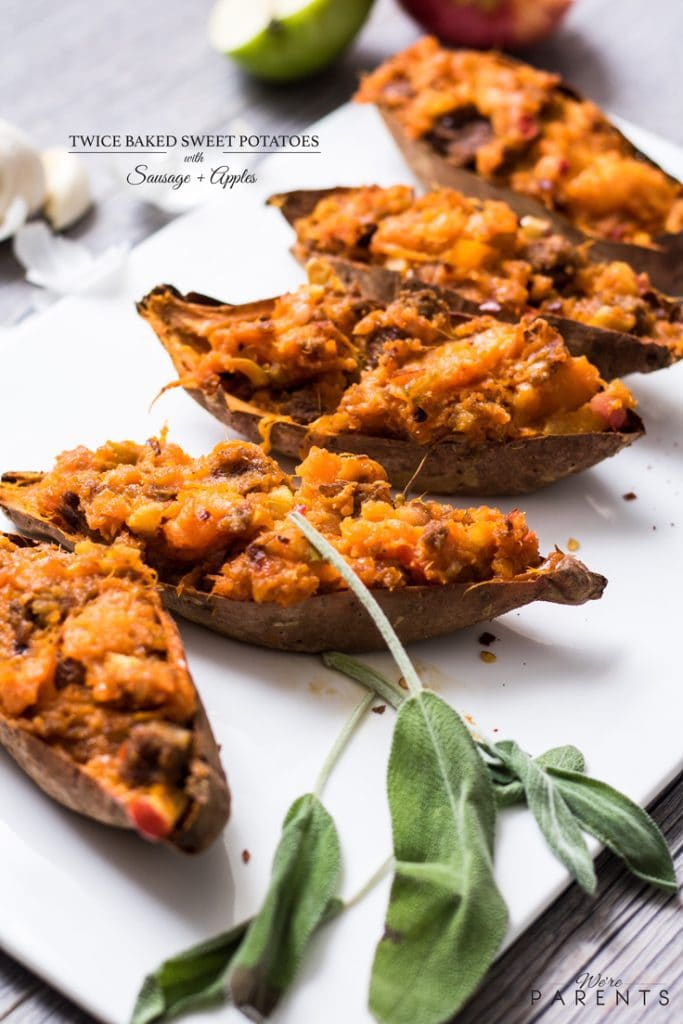 twice baked sweet potatoes with sausage and apples on a platter