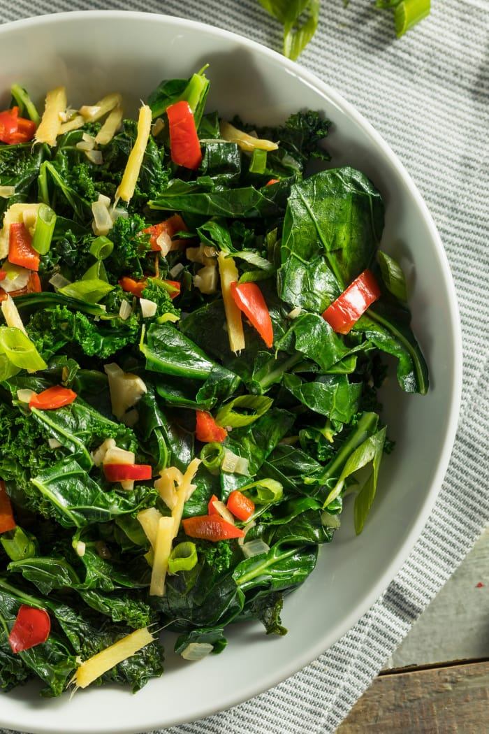 collard greens salad with pepper and ginger in a low bowl