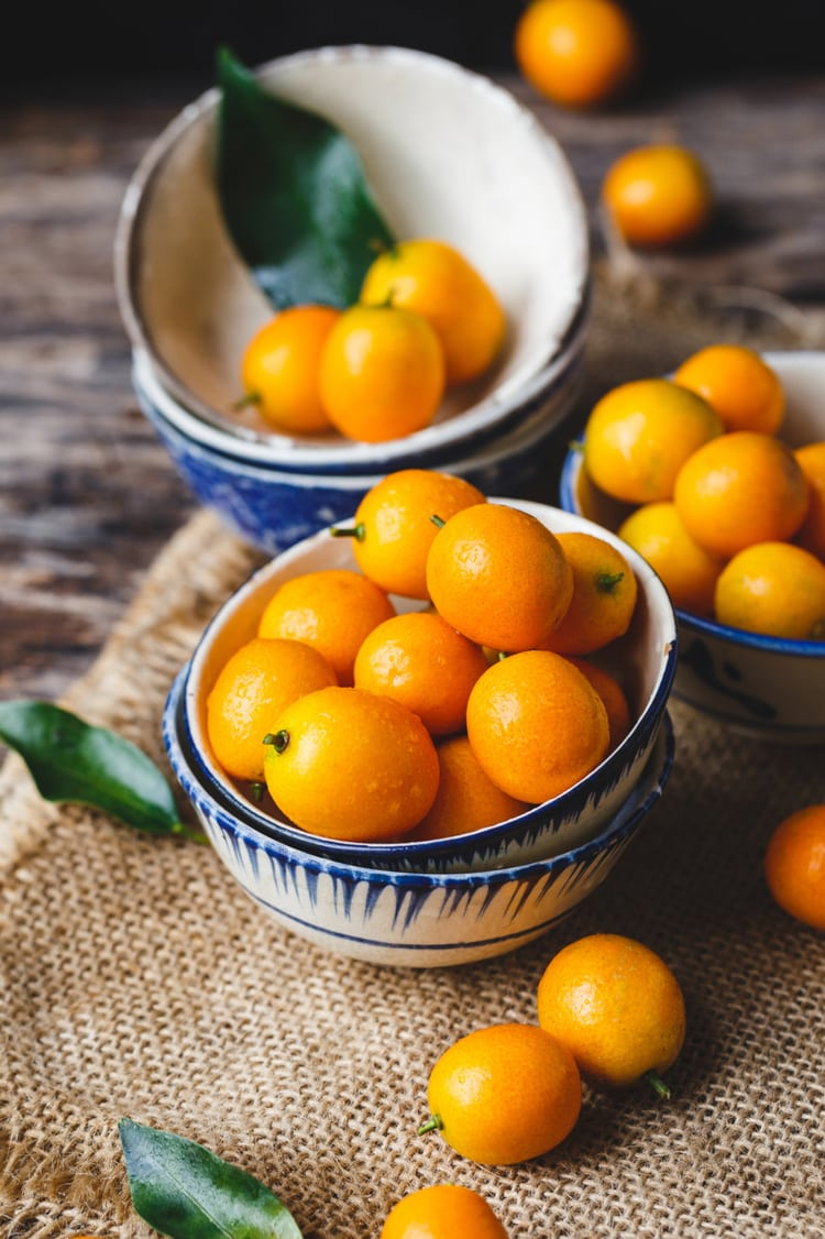 kumquats in a small bowl