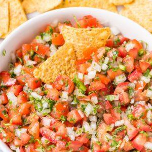 pico de gallo recipe in a bowl with tortilla chips