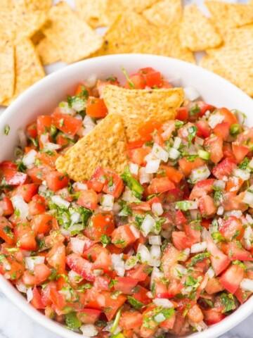pico de gallo in a bowl with tortilla chips