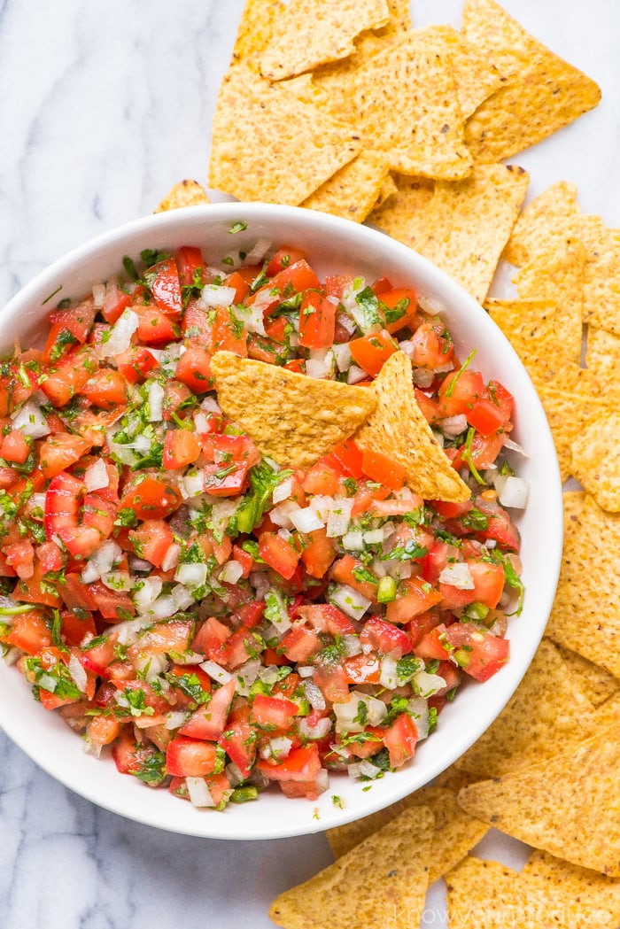 pico de gallo in a bowl with tortilla chips