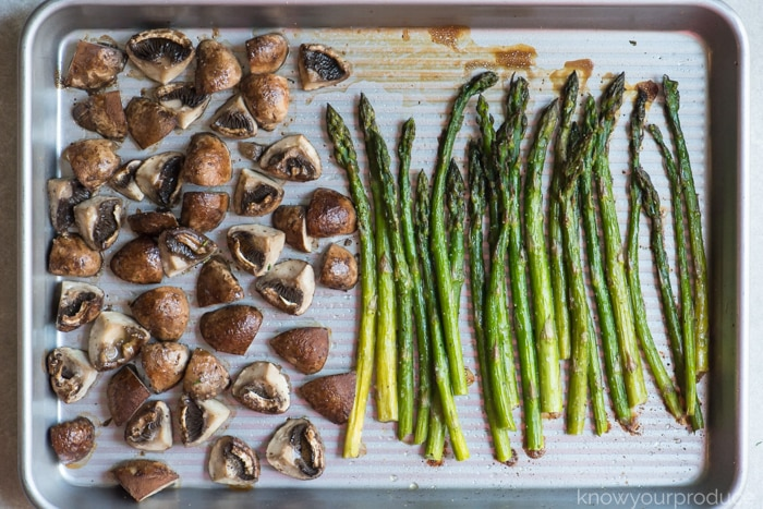 roasted asparagus and mushrooms on a sheet pan