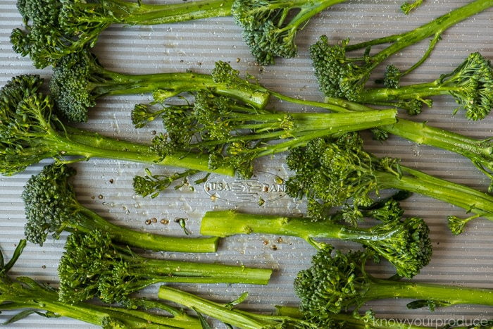 broccolini on a sheet pan for roasting