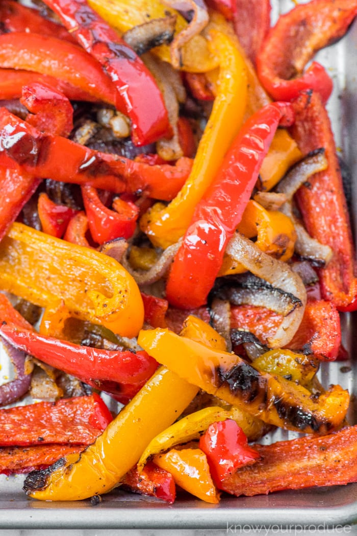 roasted peppers and onions on a sheet pan