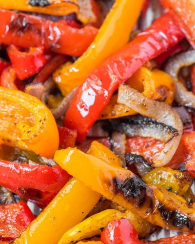 roasted peppers and onions on a baking sheet