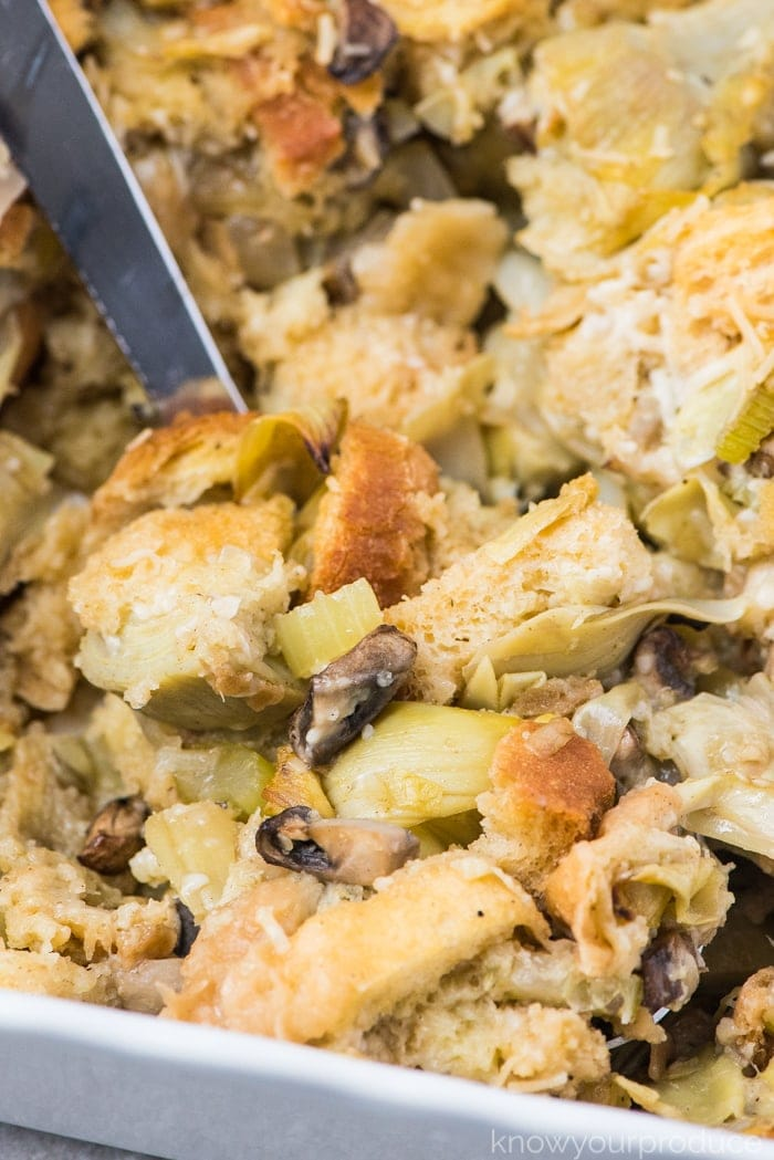 vegan stuffing with a serving spoon in a casserole dish