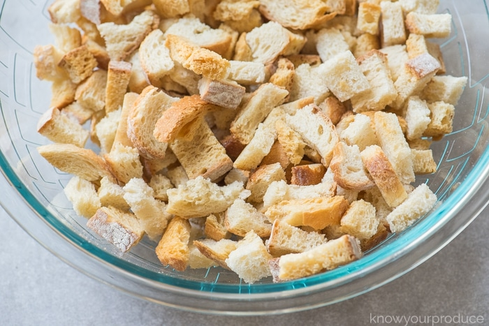 dried day old bread in a bowl for vegan stuffing