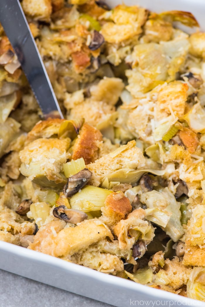vegan stuffing on a spoon in baking dish