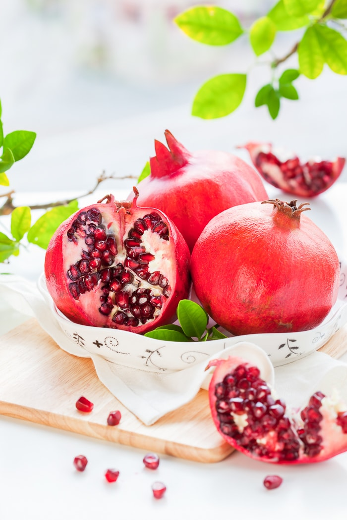 Pomegranates, whole and cut open
