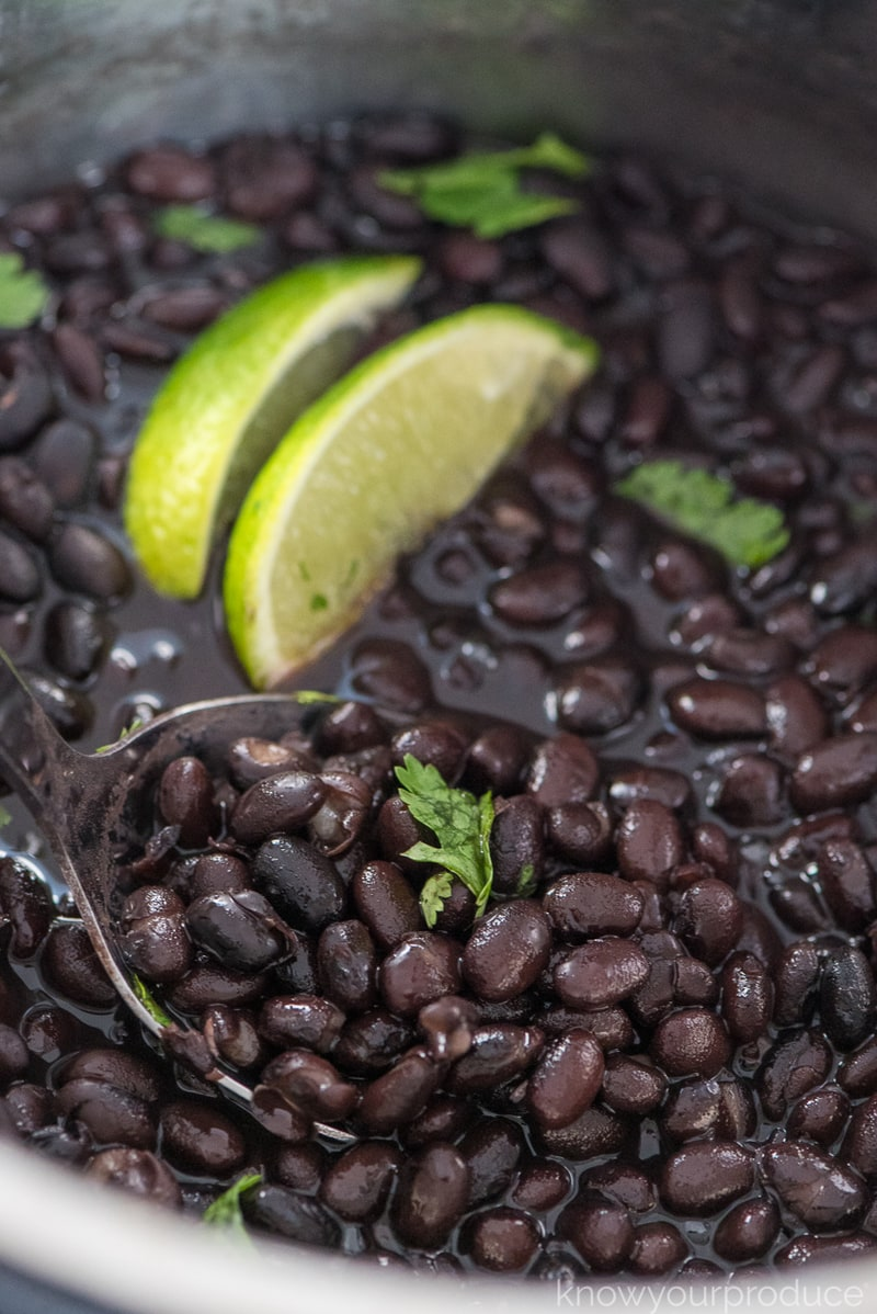 instant pot black beans with lime and cilantro garnish