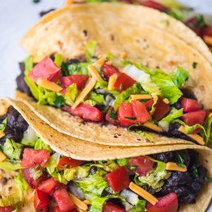 vegan black bean tacos in corn tortillas