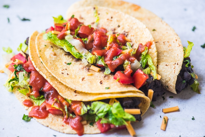 vegan black bean tacos with taco sauce