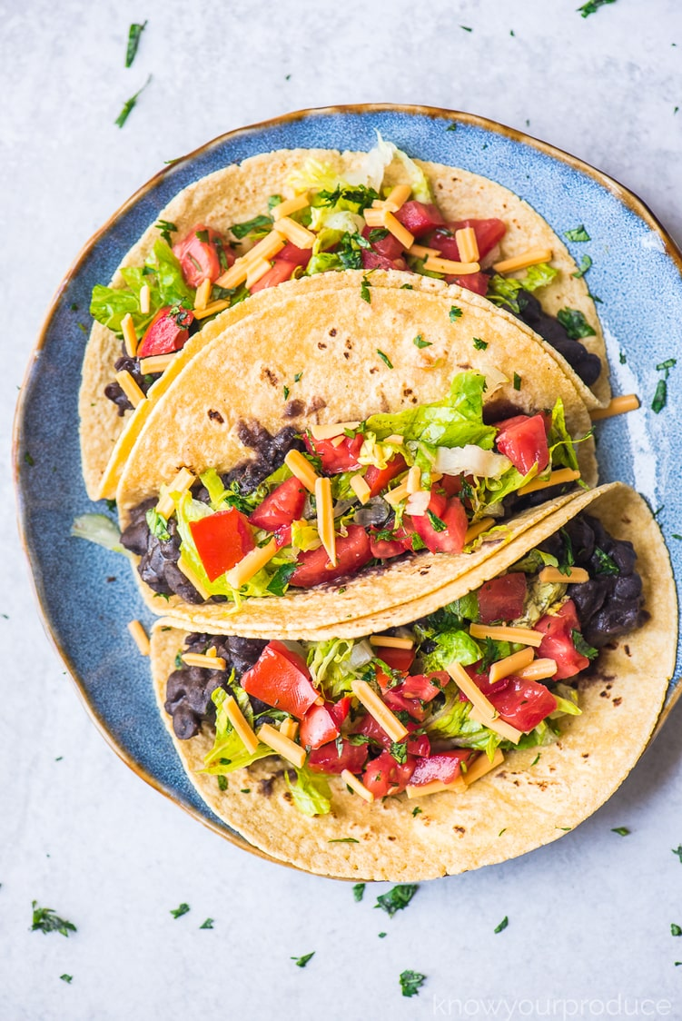 vegan black bean tacos on a blue plate