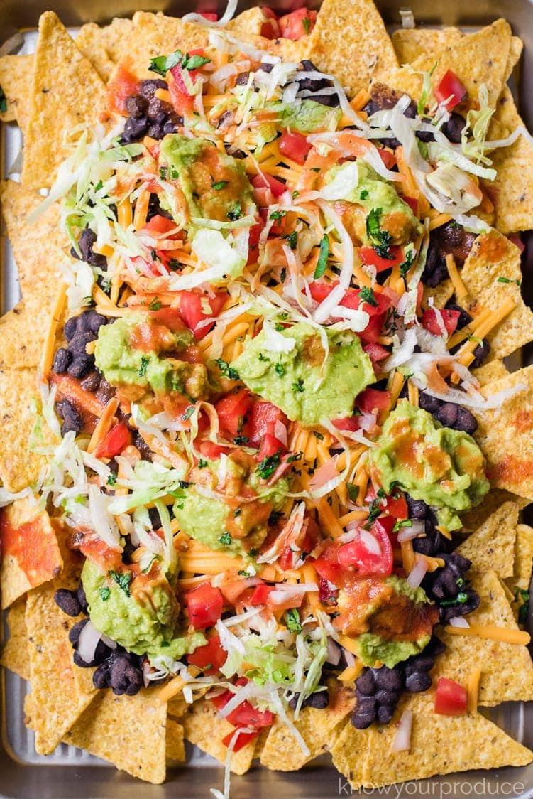 close up of nachos on a baking sheet