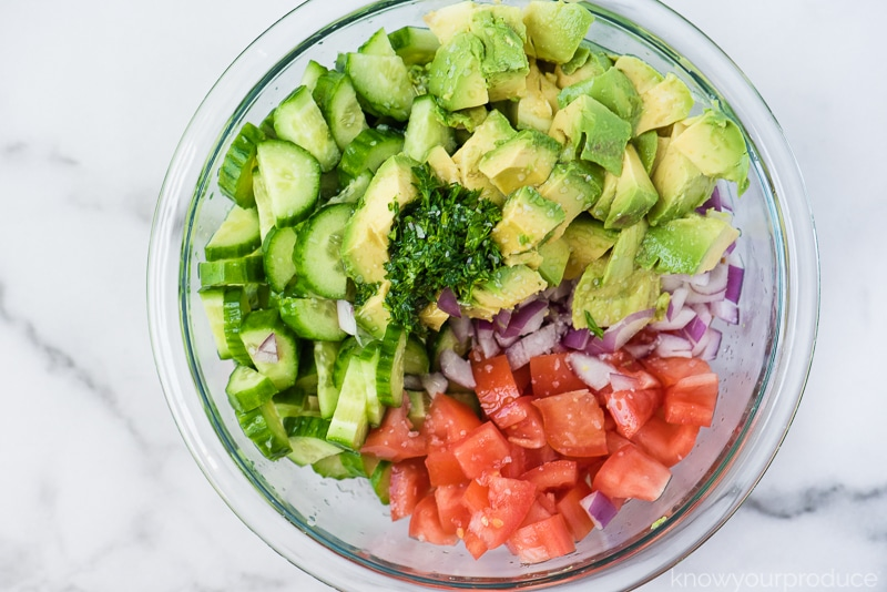 sliced and chopped vegetables in a bowl for salad
