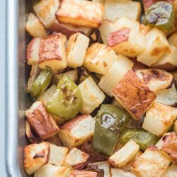 roasted breakfast potatoes on a sheet pan with peppers and onions
