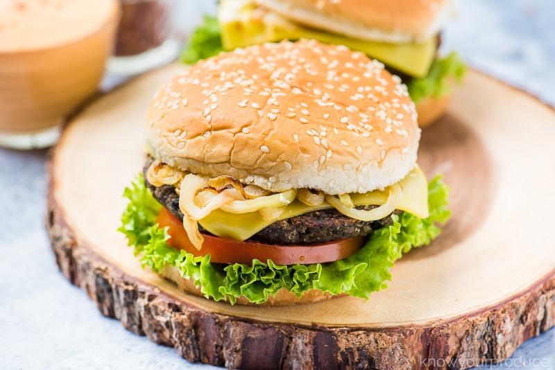 vegan black bean burgers on a wooden board