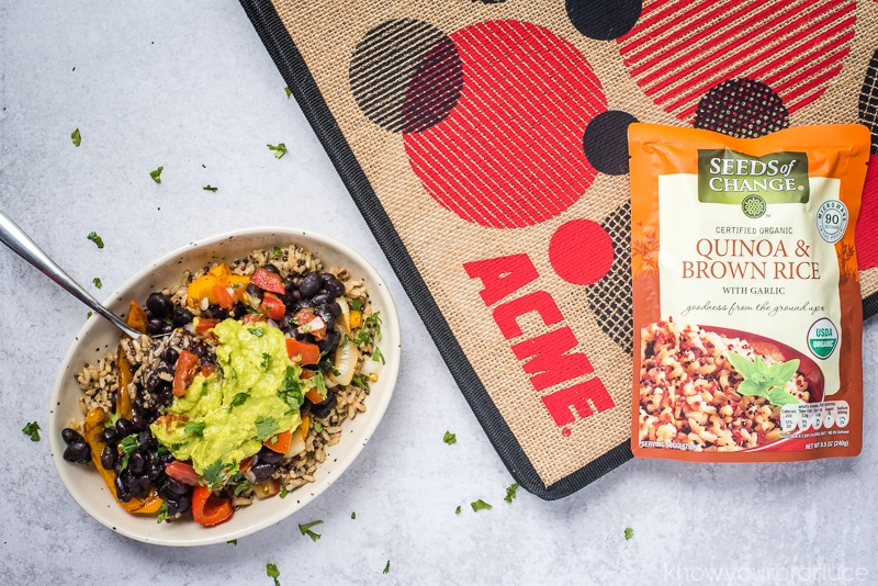 vegan burrito bowl with seeds of change rice on acme reusable shopping bag