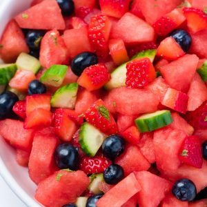 watermelon cucumbers blueberries and strawberries chopped in a bowl