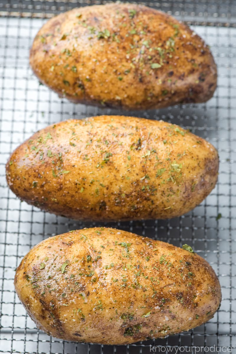 seasoned potatoes on air fryer basket