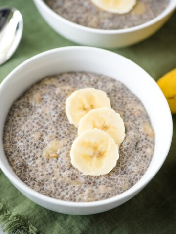 banana chia pudding in a bowl with a banana slices