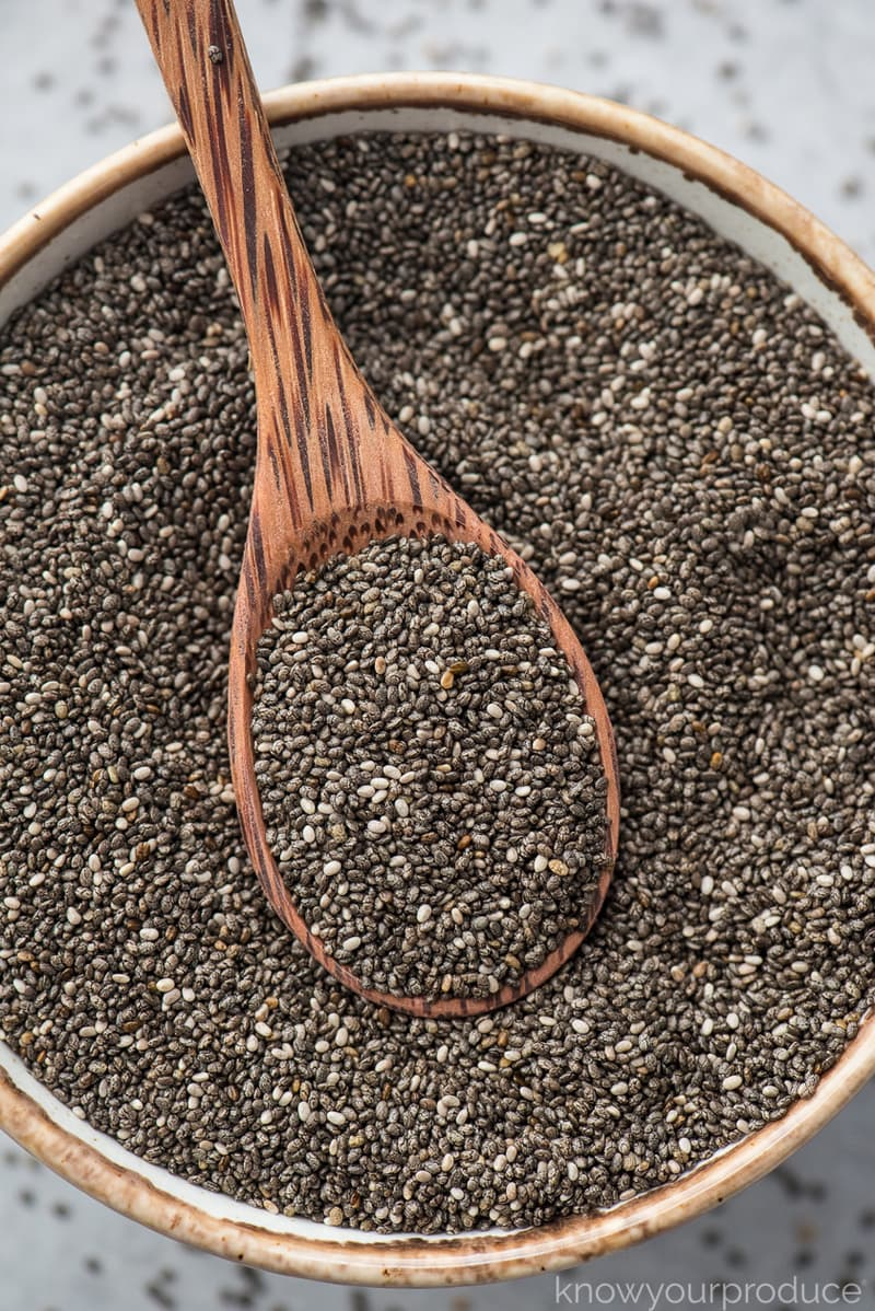 chia seeds in a bowl with a small wooden spoon