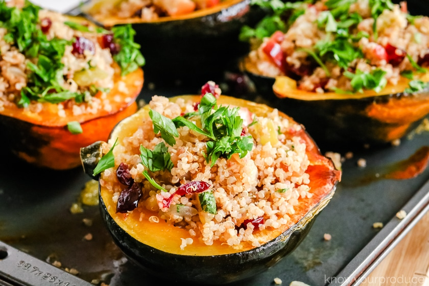 quinoa cranberry stuffed acorn squash on baking sheet
