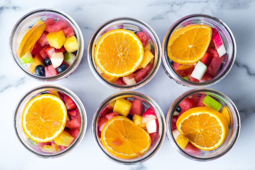 fruit salad in wide mouth glass mason jars