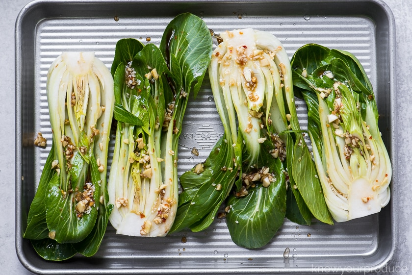 bok choy ready to roast on a baking sheet