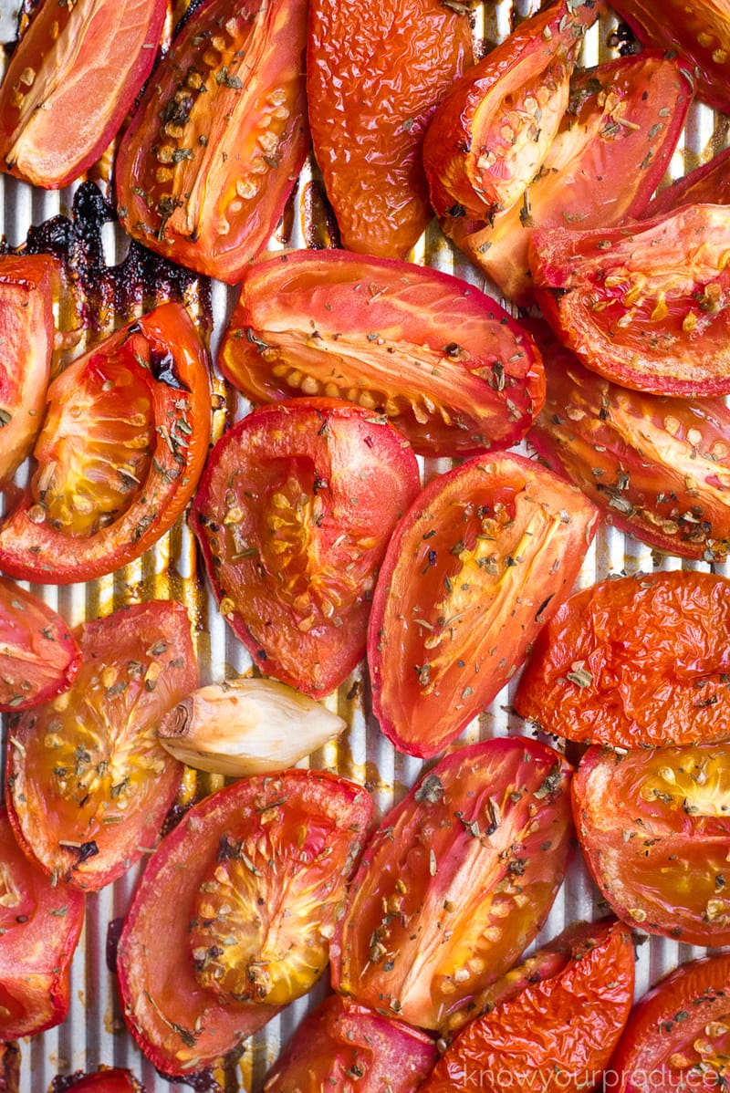 oven roasted tomatoes on a sheet pan
