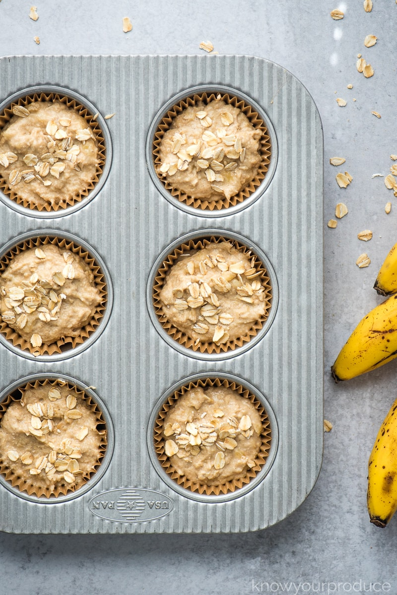 banana muffin batter in a muffin tin