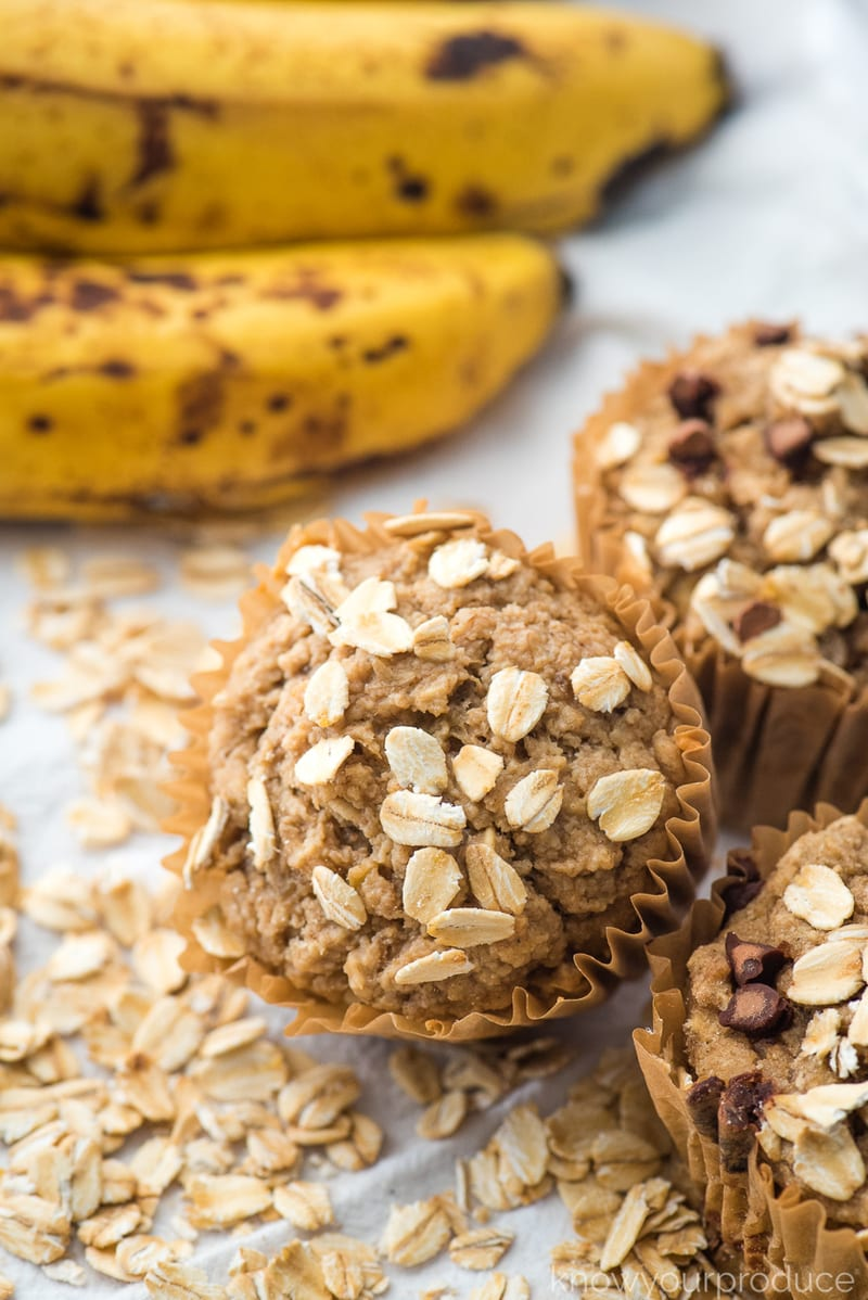healthy banana muffins with oatmeal on top and chocolate chips