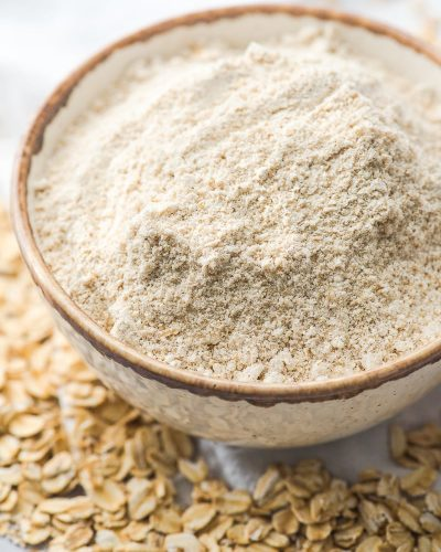 oat flour in a bowl with oats on the table