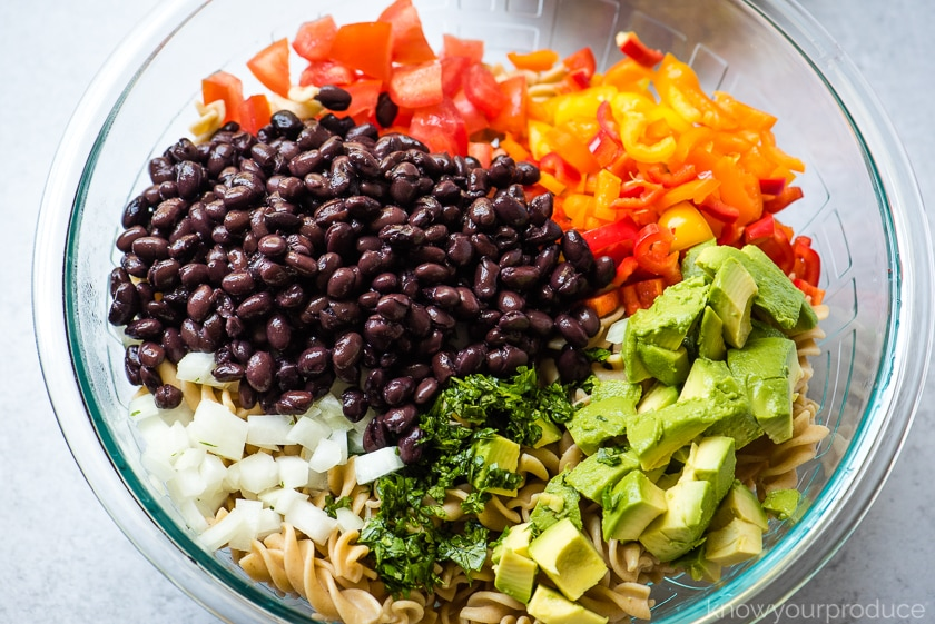 ingredients for mexican pasta salad in glass bowl