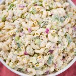 vegan tuna pasta salad in a white low bowl with spoon and pink cloth