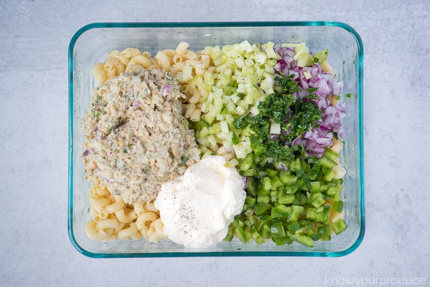 vegan tuna pasta salad ingredients in a rectangle glass pyrex dish