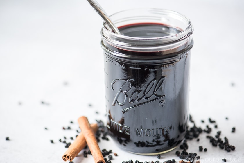 homemade elderberry syrup in a mason jar