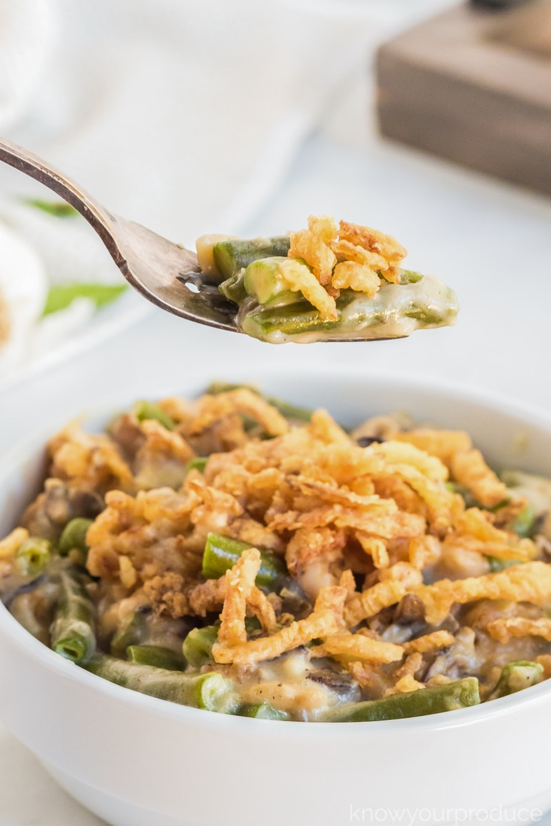 green bean casserole on fork and in mini casserole dish